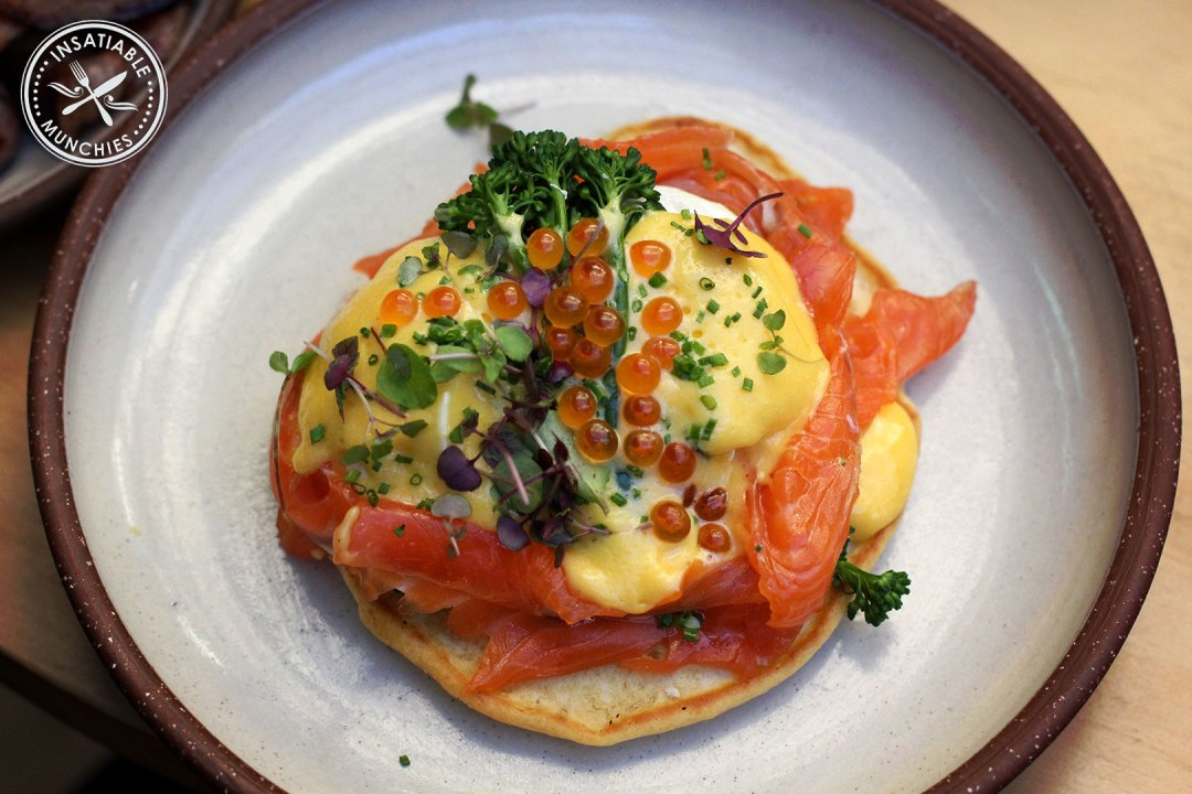 Eggs Blini: Buckwheat blini topped with poached egg, broccolini, cured salmon and sauce Mikado, a mandarin hollandaise that is a richer orange that the traditional hollandaise
