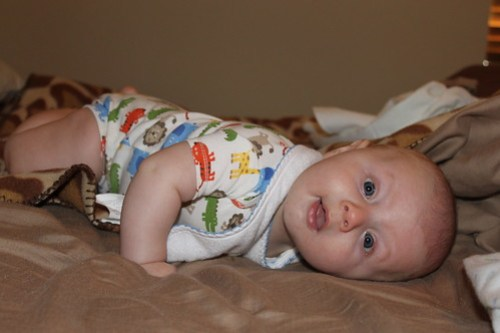 Playing on Mommy's bed