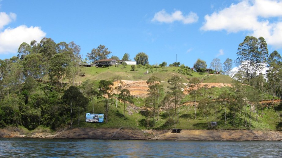 The home atop this hill belonged to the head of the Cali Cartel, one of Pablo Escobar's archenemies. The billboard below advertises a new high-end real estate development being built there.