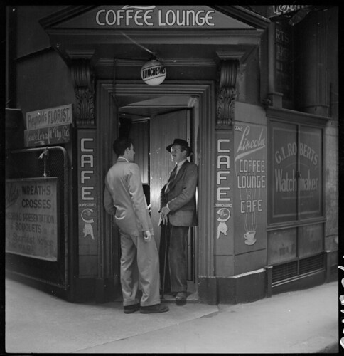 Dick Gooding (on right of door) from Lincoln Coffee Lounge & Cafe, Rowe Street, Sydney / photographed by Brian Bird c. 1948-1951