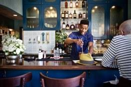 Yacine Sylla behind the bar at St. Lawrence