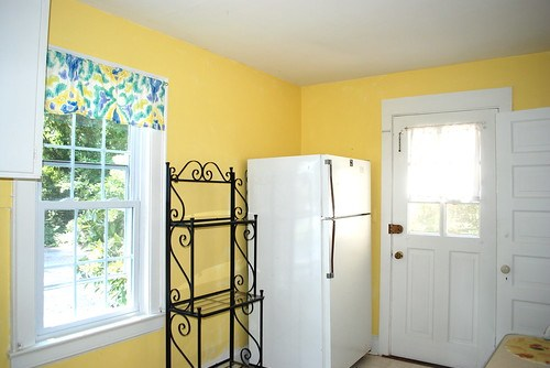 yellow cottage kitchen before