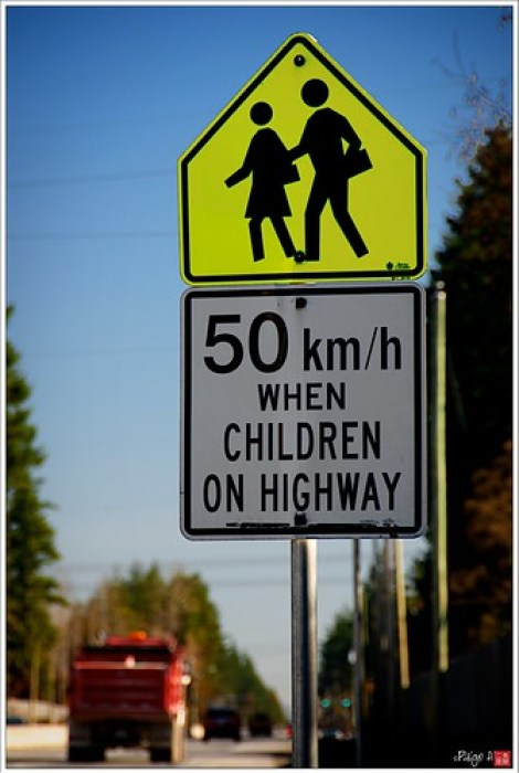 Slow to 50 km/hr when children on highway...