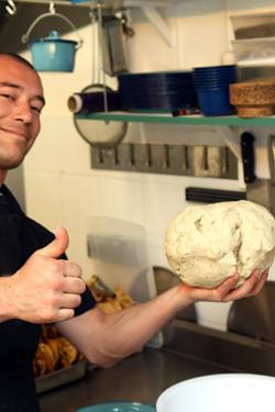 hefting tortilla dough