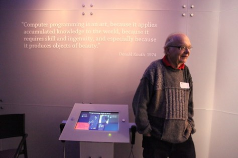 Don Knuth, in front of his quote on the wall