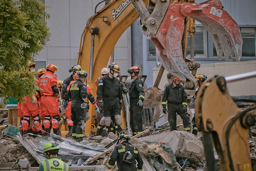Rescue workers sift through the CTV building