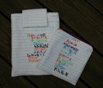 Autographed iPad pouch + zippy pouch