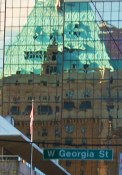 Reflection of Hotel Vancouver Rooftop