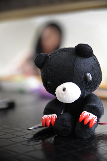 Gloomy Bear grabbing a hold of the scissors