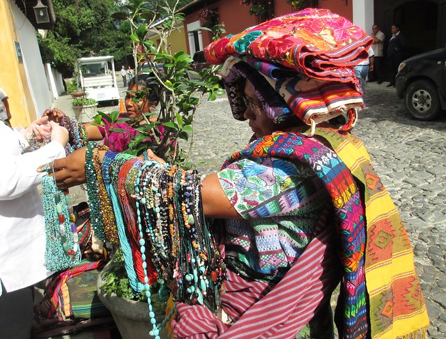 Clara's Sister Selling Fabrics, Necklaces Outside Porta Hotel, Antigua, Guatemala, May 2014