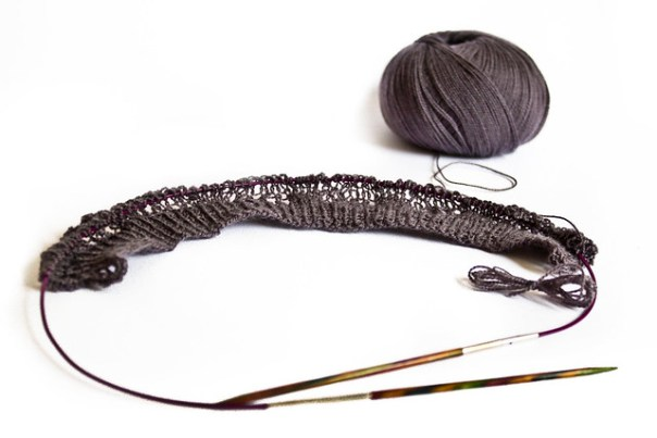 Lace knitting with charcoal grey yarn
