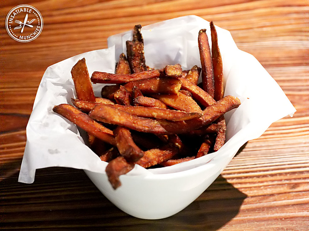 Sweet potato shoe string fries are simply topped with truffle oil, to create a rich, moreish, yet simple bite.