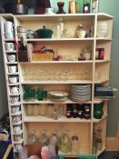 Pantry of thrift store table ware | Dock Lunch