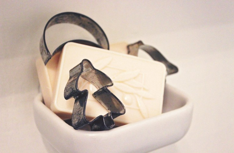 DIY Christmas Decor- Vintage Cookie cutters added to festive soap, creating a cute soap dish arrangement | Alex Inspired