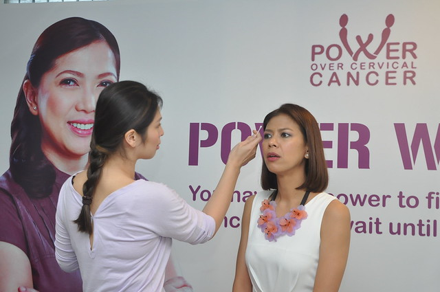 Make Up Artist Mica Tuan?o during  her demo with Host Suzi Entrata at the Power Over Cervical  Cancer, Power Wives Event 7