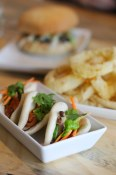 Bao, onion rings & burger in the background | The Arbor