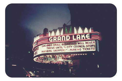 Grand Lake Theater marquee on small-business parking