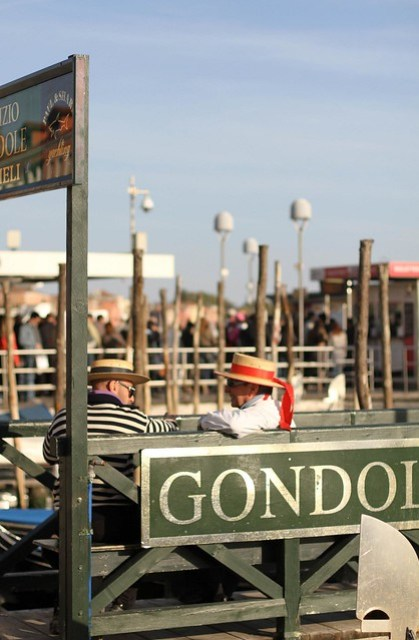 Two gondoliers taking a break, Venice, Italy