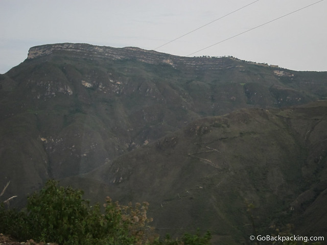 The Kuelap ruins can be seen along the right side of the mountain ridge, where there are trees