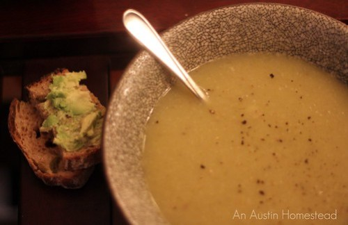 Warm soup with crusty bread and avocado