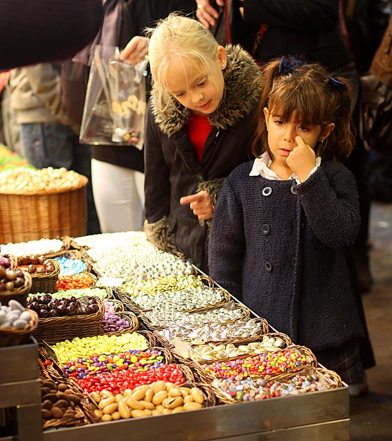 Two children want candy, La Boqueria, Barcelona, Spain