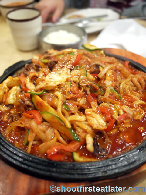 noodles stir fried with calamari & vegetables in spicy sauce $17.99
