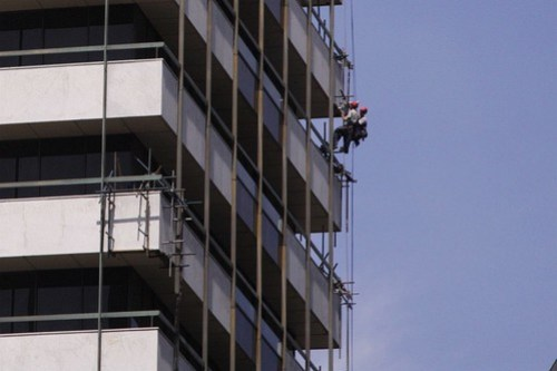 Temporary scaffolding to hold the facade panels in place