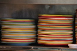 Colourful plate stacks at Los Cuervos