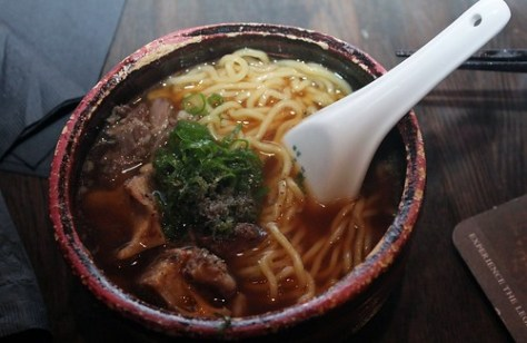 Tokyo Oxtail Ramen slowly braised oxtail & noodles in soy broth topped with dried fish powder & scallions