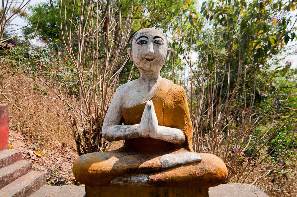 Praying Monk statue at Octagonal Pavilion