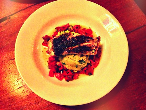 Crispy grilled barramundi, basil mash potato, chorizo, capsicum and orange reduction