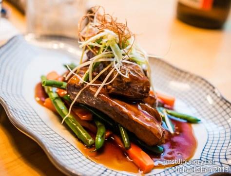 Kuki tanuki Tender buta pork ribs - marinated in a teriyaki sauce & served w/seasonal veggies