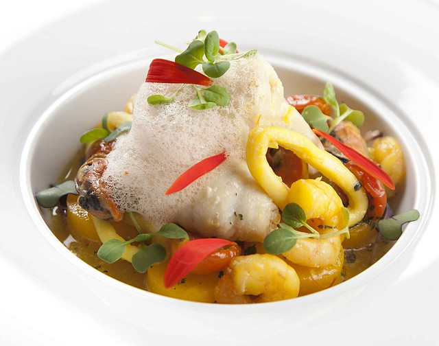Steamed Dover sole paupiette with seafood stew and lobster broth