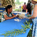 Niihau lei maker Kanani Beniamina demonstrates the art of shell lei crafting to Smithsonian Folklife Festival visitors at the University of Hawaii exhibit.