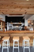 Bar seats with a view of the open kitchen at Kuma Tofino