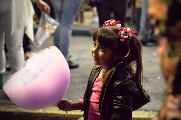 Little girl with huge cotton candy flower
