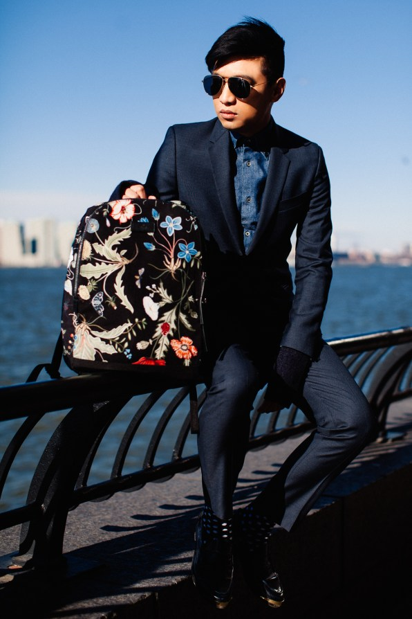 Bryanboy in New Yorm City carrying a Gucci canvas backpack