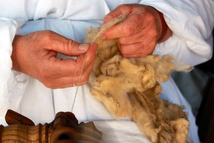 Close-up of hands spinning wool ~ Burgfest