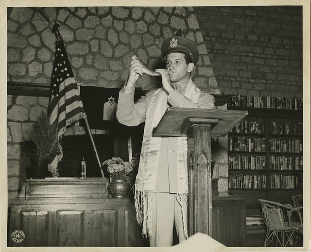 Captain Joseph H. Freedman Hq, USAFIME, is shown blowing the Shofar