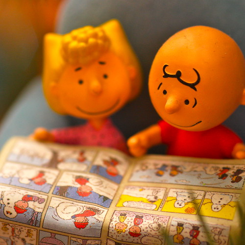 Christmas decorations - Charlie Brown and Sally read the Sunday comics
