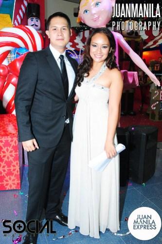 JC Cuadrado and Sarah Hernandez posing for the camera.