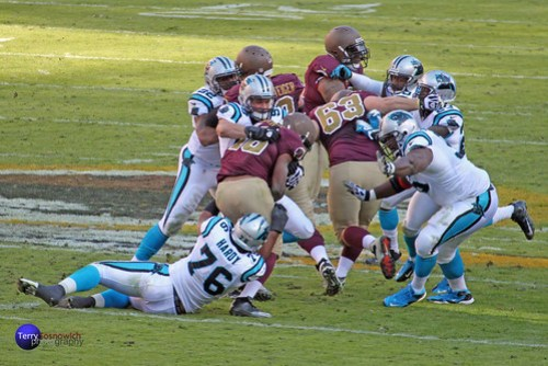 Carolina Panthers defense tackles RB Alfred Morris (46).