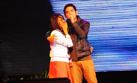 A fan had the joy of her life when she was picked up on stage to join the heartthrob.