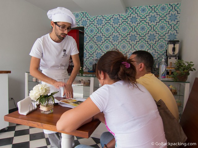 Marcela's brother helps a couple choose cupcakes for their wedding