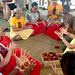 University of Hawaii delegates teach hei, a traditional Hawaiian string game, at the UH tent at the Smithsonian Folklife Festival.