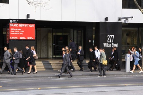 Morning commuters head down Melbourne's William Street