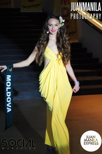 Aliona Chitoroaga from Moldova wears a beautifully strapped yellow gown.