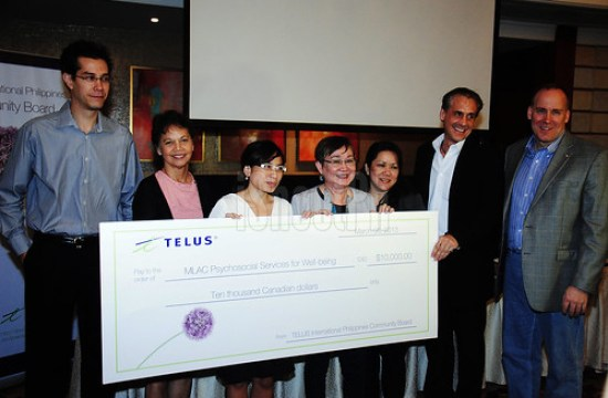 MLAC Psychosocial Services for Well-being receives their grant from TIP Community Board.