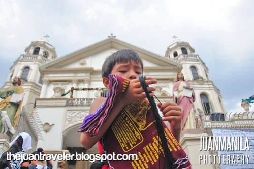 Little boy sells Black Nazarene handkerchiefs.