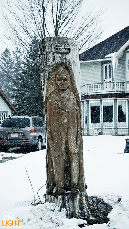 the founder of Durham, ON carved into a log
